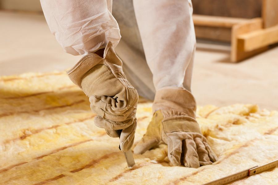 asbestos specialist working on insulation