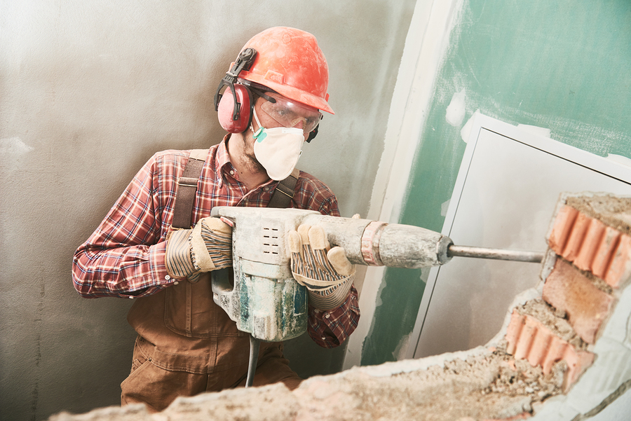 asbestos specialist working on removal service